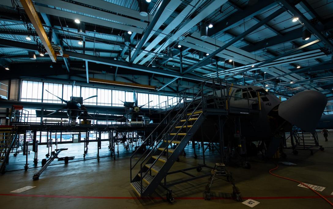 A C-130J Super Hercules aircraft undergoes an isochronal inspection in a maintenance hangar