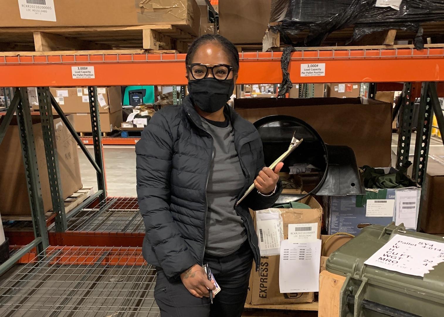 Shontavia Ortega examining items in a warehouse