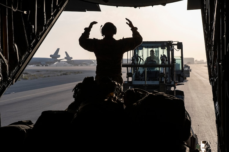 A U.S. Air Force C-130 Hercules aircraft is loaded with cargo at Ali Al Salem Air Base, Kuwait, during an Air Forces Central Agile Combat Employment capstone mission March 3, 2021.