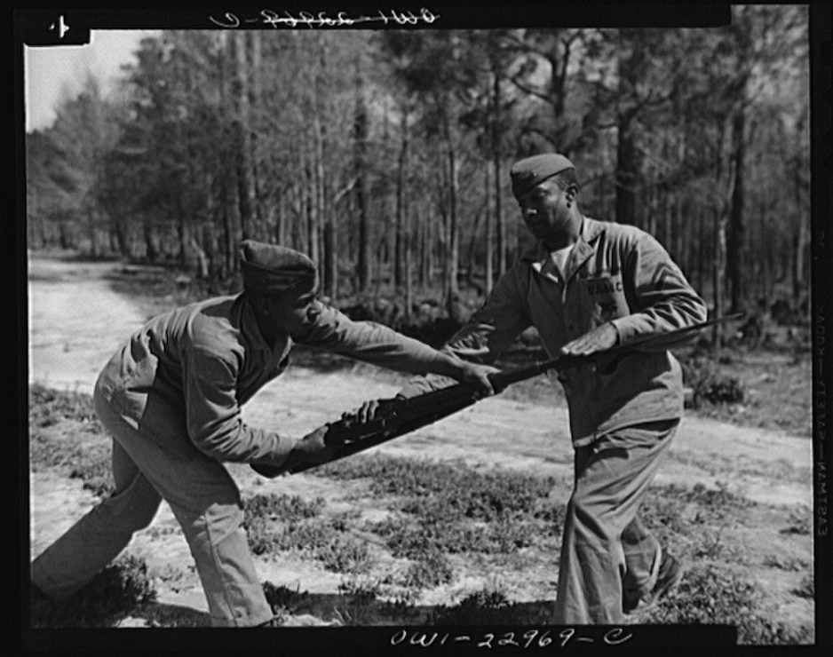 Cpl. Arvin L. Ghazlo demonstrates to a bayonet class a technique for disarming the enemy. Breaking a tradition of 167 years, the Marine Corps started enlisting blacks, June 1, 1942.