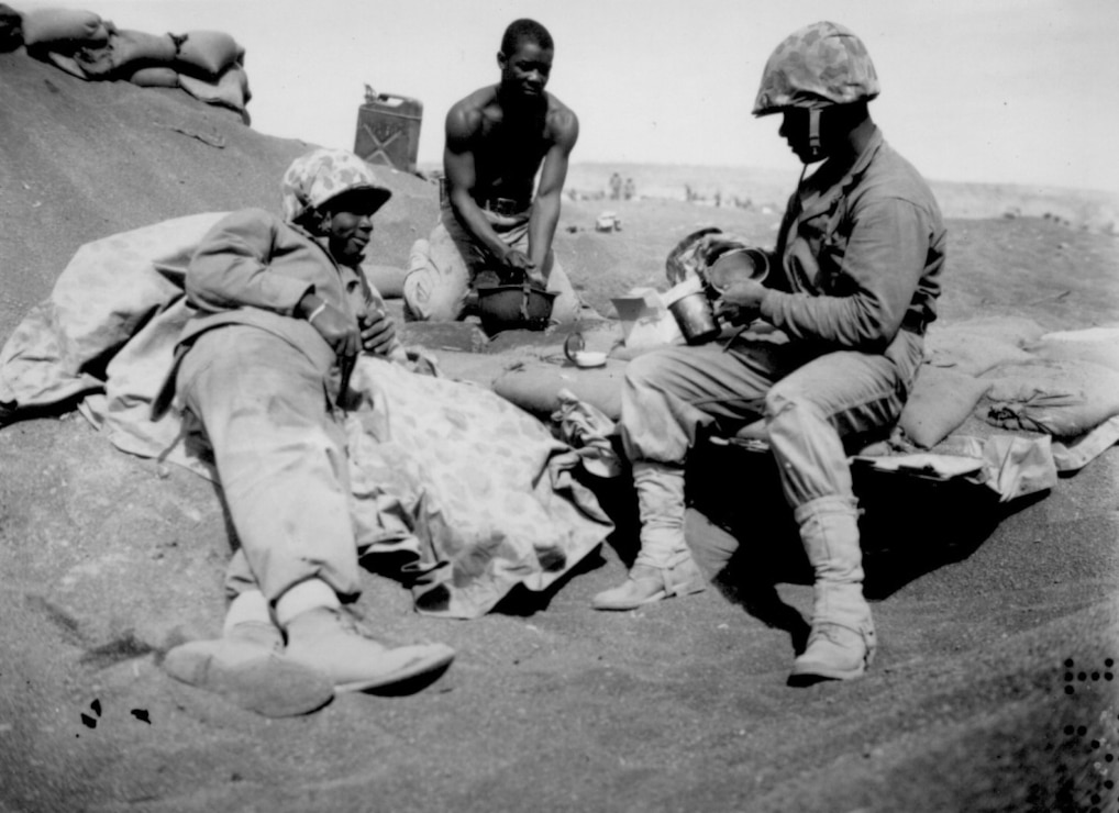 Black Marines on the beach at Iwo Jima are, from left to right, Pfc.'s Willie J. Kanody, Elif Hill and John Alexander, March 1945.