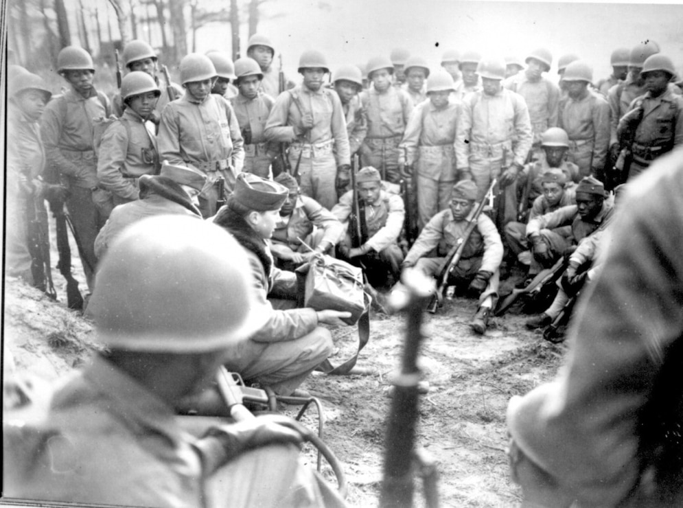 Marines receiving instruction in the demolition course at Montford Point, Camp Lejeune, N.C., during intensive combat training in preparation for action in the Pacific, February 1945.