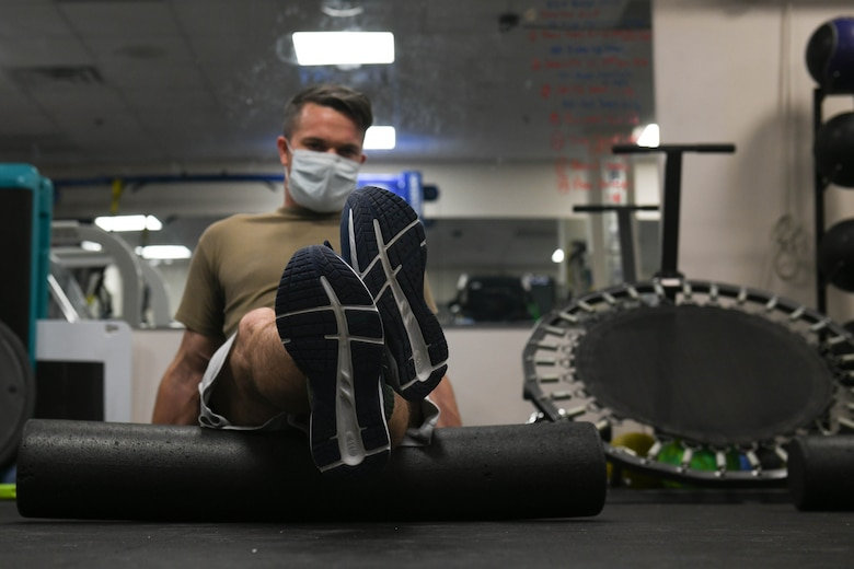 Tech. Sgt. David Ferricher, 22nd Maintenance Squadron metals technician, foam rolls his hamstrings Mar. 3, 2021, at McConnell Air Force Base, Kansas. The benefits of foam rolling include enhanced joint range of motion, delayed onset of fatigue and accelerated post recovery. (U.S. Air Force photo by Senior Airman Nilsa Garcia)