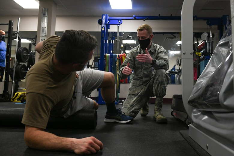 Tech. Sgt. David Ferricher, 22nd Maintenance Squadron metals technician, attends a foam rolling class Mar. 3, 2021, at McConnell Air Force Base, Kansas. The physical therapy clinic at McConnell offers Airmen the opportunity to attend a free foam rolling class every Tuesday at 2:00 p.m. (U.S. Air Force photo by Senior Airman Nilsa Garcia)