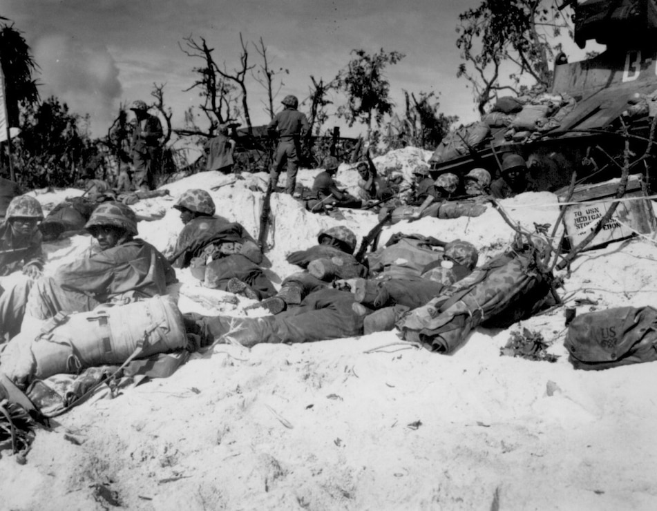 Marines move through the trenches on the beach during the Battle of Peleliu, Sept. 15, 1944.