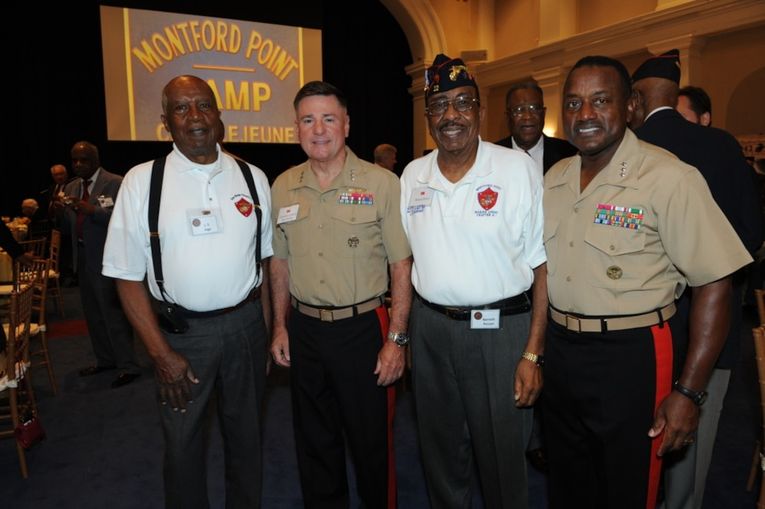From left, J.T. Inge, U.S. Marine Lt. Gen. Terry Robling, the deputy commandant for aviation; Barnett Person; and Lt. Gen. Willie J. Williams, the director of Marine Corps Staff, pose for a photo during the breakfast in honor of Montford Marines at Crawford Hall at Marine Barracks Washington, Washington, D.C., Aug. 26, 2011.