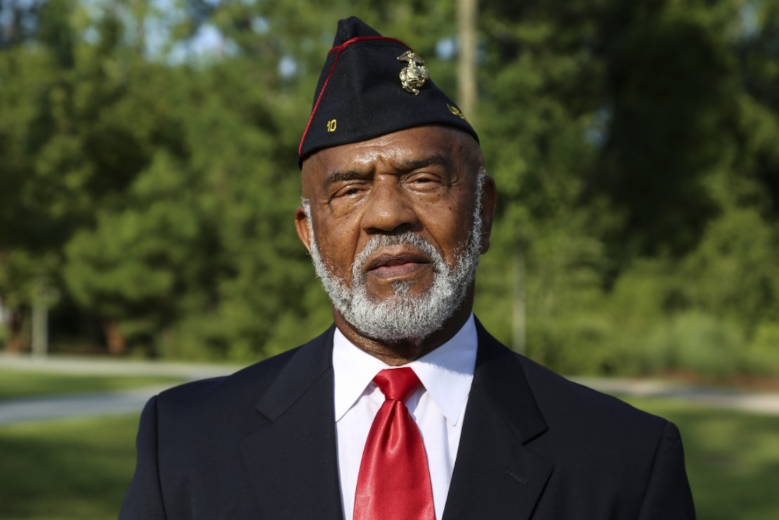 James L. Spann, a veteran that served at Montford Point, poses for a photo at the Montford Point Marines Memorial on Marine Corps Base Camp Lejeune, Aug. 22, 2019.