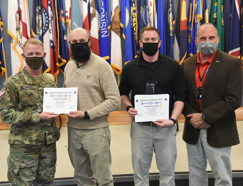 Participants in the Virginia Department of Military Affairs' first-ever mentorship program graduate during a ceremony Feb. 25, 2021, at Fort Pickett, Virginia.
