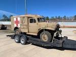 A World War II ambulance sits on a trailer at the Army Museum Support Center's outdoor storage facility at Anniston, Alabama, Jan. 28 awaiting transport to the Alabama Center of Military History.