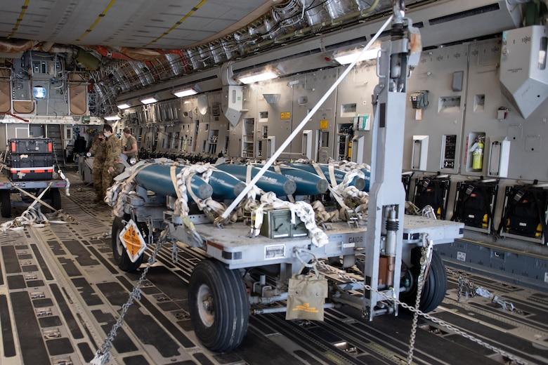 A photo of a munitions trailer on an aircraft