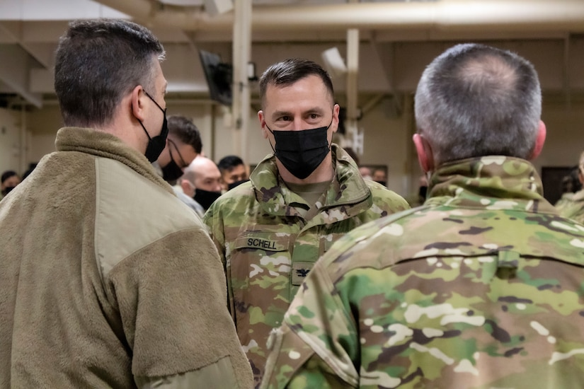 Col. Matthew Schell, commander of the 297th Regional Support Group, speaks with Maj. Gen. Torrence Saxe, adjutant general of the Alaska National Guard, and Chief Master Sgt. Winfield Hinkley, the senior enlisted leader for the Alaska National Guard, after the 297th RSG returned to Alaska from their nine-month long deployment in Poland, March 4, 2021, where they supported Operation Atlantic Resolve. Atlantic Resolve is a Department of Defense mission dedicated to demonstrating the continued commitment to peace, security and stability in Europe by the United States. (U.S. Army National Guard photo by Spc. Grace Nechanicky)
