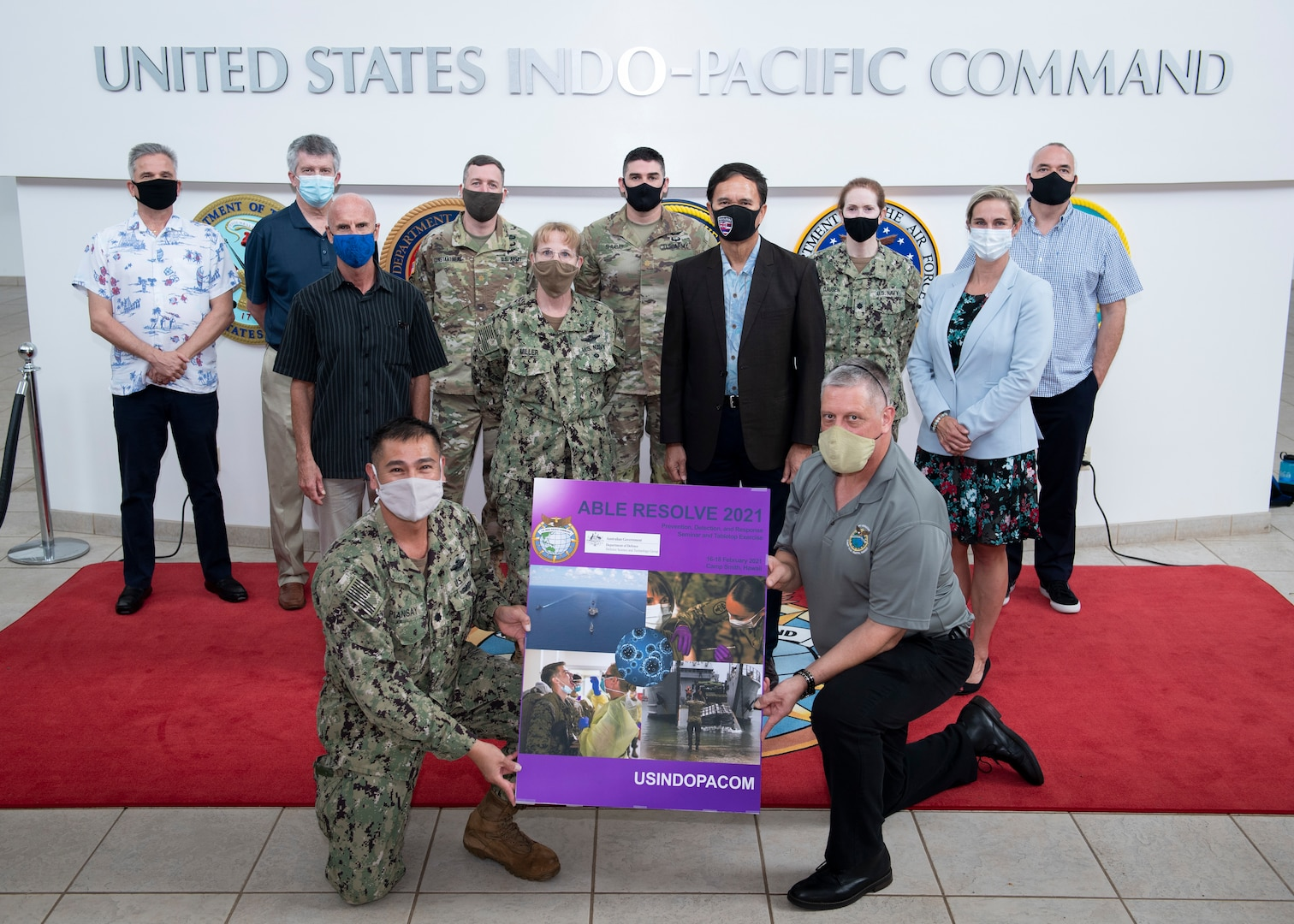 Participants of Exercise Able Resolve pose for a group photo Feb. 18, 2021, at the U.S. Indo-Pacific Command headquarters on Camp Smith, Hawaii. The exercise focused on biological-threat surveillance decision support and knowledge management.