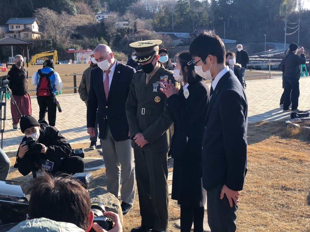 """On March 7, Marines from the U.S. Embassy Tokyo and 3D Marine Expeditionary Brigade attended the Oshima Island 10-year anniversary of the 3-11 Great East Japan Earthquake, tsunami and nuclear disaster and subsequent US response Operation Tomodachi. The people of the island unveiled a memorial inscribed with """"Friendship Forever,"""" honoring the strong relationship between themselves and Okinawa Marines. Attendees included city officials and citizens who survived the disaster and worked with the 31st Marine Expeditionary Unit which conducted extensive humanitarian assistance and disaster relief in the area. The work underscored the importance of interoperability with our Japan Self-Defense Force partners in support of the Japan/US alliance. 3D MEB also responded to the disaster, working in Sendai area, and remains resilient, ready and relevant to work with our Japanese friends to respond to crisis in the future."""