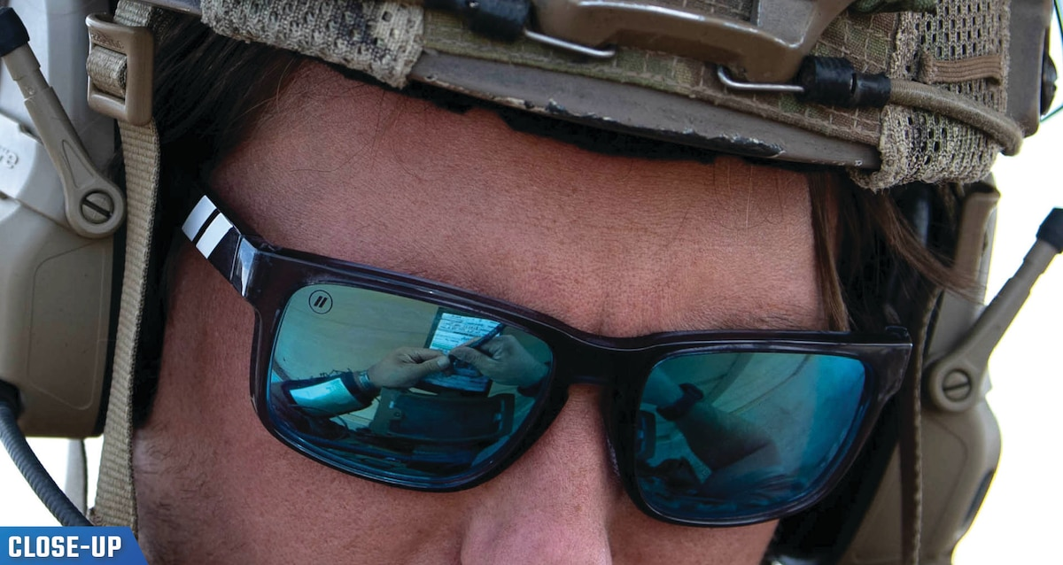 Close up photo of a military service (ST Wing) man's face wearing a helmet and sunglasses