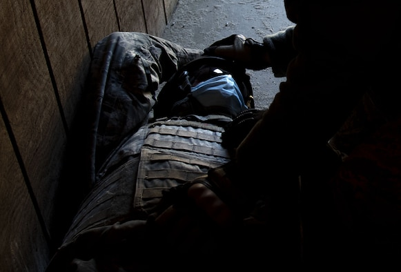 Photo of a religious support Airman providing religious triage during pre-deployment training.
