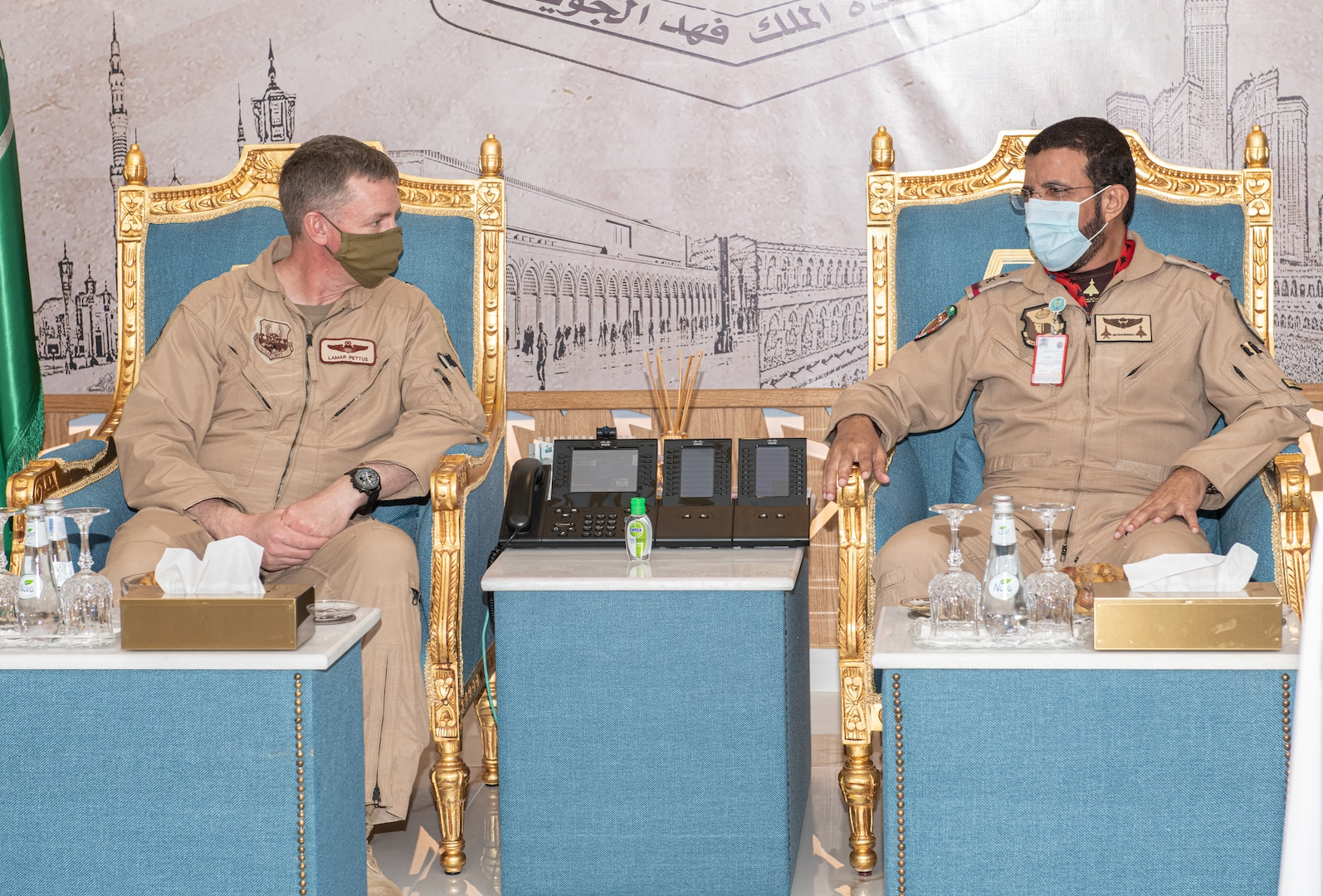 Brig. Gen. Evan Pettus, 378th Air Expeditionary Wing commander, speaks with the Royal Saudi Air Force King Fahad Air Base commander during an Agile Combat Employment capstone event Feb. 27, 2021, at an airbase in the Kingdom of Saudi Arabia.