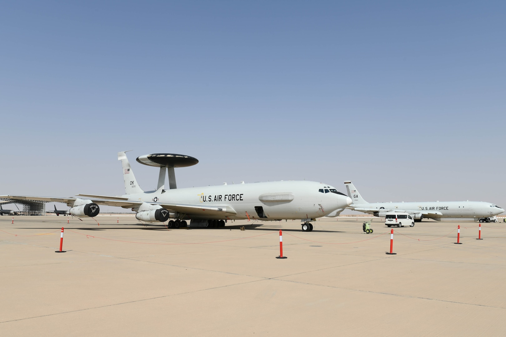 An E-3 Sentry (AWACS) and E-8C Joint Surveillance Target Attack Radar System aircraft sit on the flightline at Prince Sultan Air Base, Kingdom of Saudi Arabia, March 1, 2021.