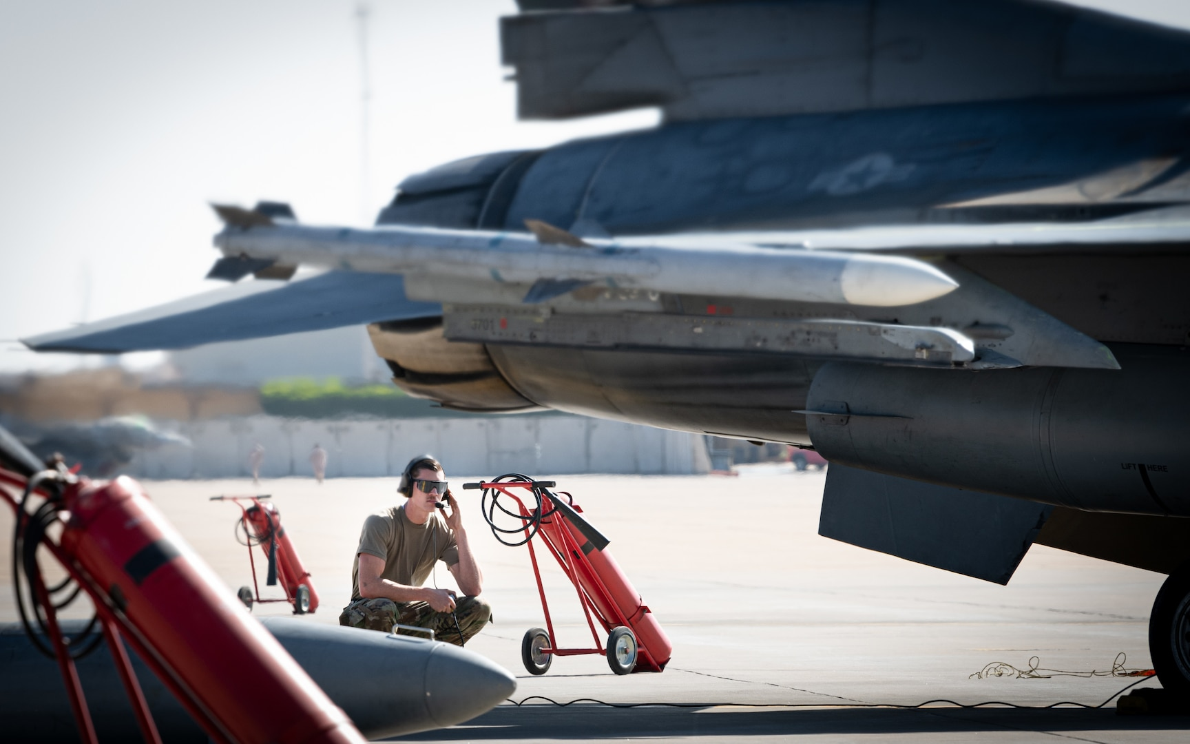 Senior Airman Lowe, 77th Expeditionary Fighter Generation Squadron crew chief, readies an F-16 Fighting Falcon for a mission during an Agile Combat Employment capstone event Feb. 27, 2021, at an airbase in the Kingdom of Saudi Arabia.