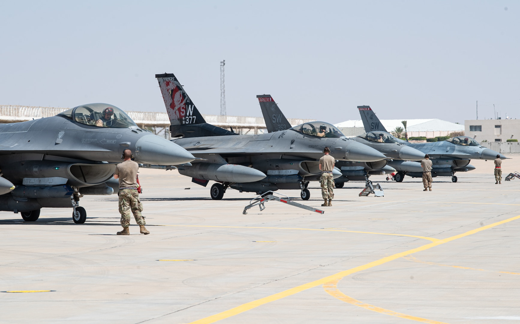 Crew chiefs from the 77th Fighter Generation Squadron and 77th Expeditionary Fighter Squadron pilots prepare for flight during an Agile Combat Employment capstone event March 5, 2021, at an airbase in the Kingdom of Saudi Arabia.