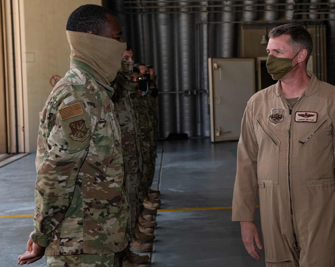Brig. Gen. Evan Pettus, 378th Air Expeditionary Wing commander, speaks with Airmen from the 378th Expeditionary Maintenance Squadron ahead of an Agile Combat Employment capstone event Feb. 27, 2021, at an airbase in the Kingdom of Saudi Arabia.