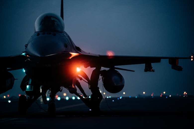A U.S. Air Force F-16 Fighting Falcon aircraft assigned to the 77th Expeditionary Fighter Squadron at Prince Sultan Air Base, Kingdom of Saudi Arabia, undergoes a hot refueling operation performed by Airmen with the 379th Expeditionary Maintenance Group and 379th Expeditionary Logistics Readiness Squadron at Al Udeid Air Base, Qatar, Mar. 1, 2021. F-16s received fuel with their engines still running in order to rapidly redeploy back into U.S. Central Command's area of responsibility during an Air Forces Central Agile Combat Employment capstone event. The capstone event enhanced theater ACE competencies, validating operational capabilities and command and control while simultaneously strengthening joint and regional partnerships.