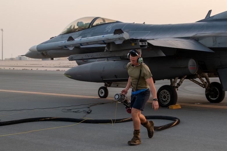 A U.S. Air Force F-16 Fighting Falcon aircraft assigned to the 77th Expeditionary Fighter Squadron at Prince Sultan Air Base, Kingdom of Saudi Arabia, undergoes a hot refueling operation performed by Airmen with the 379th Expeditionary Maintenance Group and 379th Expeditionary Logistics Readiness Squadron at Al Udeid Air Base, Qatar, Mar. 1, 2021. F-16s received fuel with their engines still running in order to rapidly redeploy back into U.S. Central Command's area of responsibility during an Air Forces Central Agile Combat Employment capstone event.
