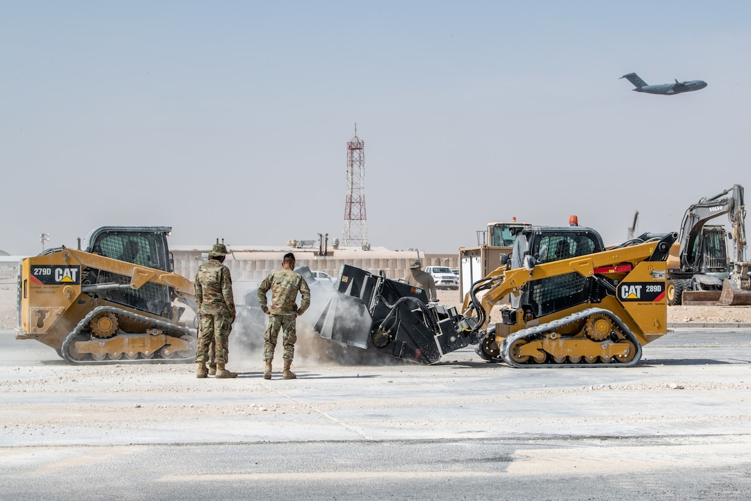 Airmen assigned to the 379th Expeditionary Civil Engineer Squadron perform rapid airfield damage repair during an Air Forces Central Agile Combat Employment capstone event March 3, 2021, at Al Udeid Air Base, Qatar. The training allows the 379th ECES to implement improved processes to enhance RADR capabilities, ensuring airfield repair can be done as expeditiously as possible after an attack.