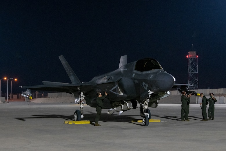 A U.S. Marines prepare to launch an F-35B Lightning II aircraft, assigned to the Marine Medium Tiltrotor Squadron 164 (Reinforced), 15th Marine Expeditionary Unit, by conducting a foreign object debris clearance walk during an Air Forces Central Agile Combat Employment Capstone event at Al Udeid Air Base, Qatar, March 3, 2021. The F-35B Lightning II is the U.S. Marine Corps variant of the 5th generation fighter. The capstone event enhanced theater ACE competencies, validating operational capabilities and command and control while simultaneously strengthening joint and regional partnerships.