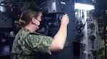 Lt. Taylor Butler, an Olmsted Scholar currently pursuing a Master's degree in Brazil, uses a stadometer to estimate range with the attack periscope aboard the Brazilian Navy Submarine BNS Tupi (S30), March 4, 2021. Butler embarked on Tupi for four days at sea to help increase the exchange of knowledge between U.S. and Brazilian submarine forces. U.S. Naval Forces Southern Command/U.S. 4th Fleet supports USSOUTHCOM joint and combined military operations by employing maritime forces in cooperative maritime security operations in order to maintain access, enhance interoperability and build enduring partnerships that foster regional security and promote peace, stability and prosperity in the Caribbean, Central and South American regions. (Courtesy U.S. Navy photo/Released)