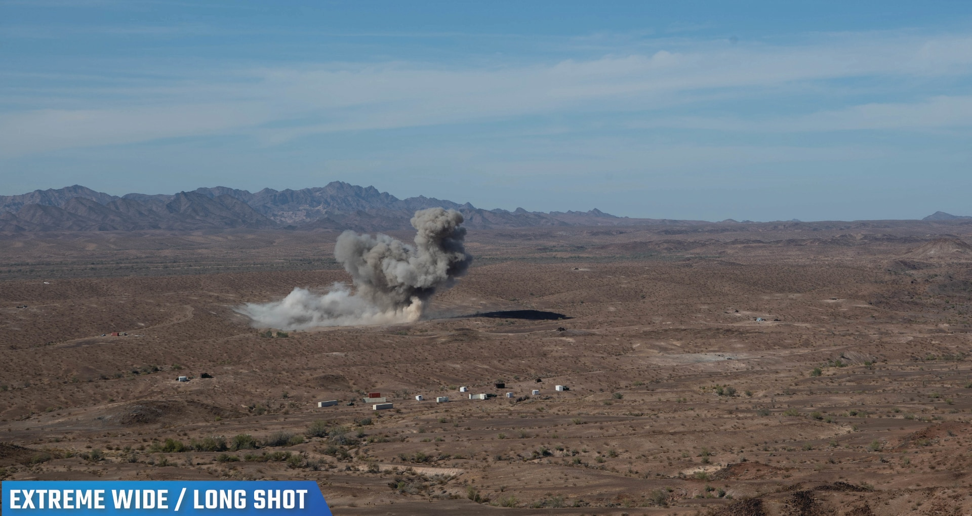 Photo of a desert-like landscape with smoke where a Bomb Squadron accurately struck a target during a Special Operations Terminal Attack Controller Course