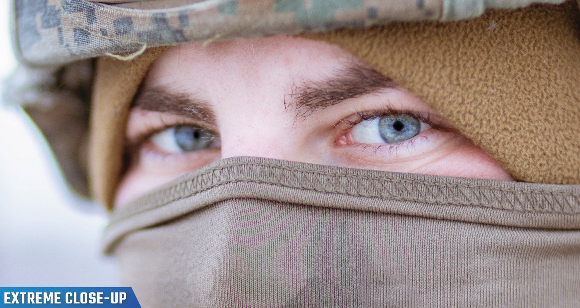 Photo of U.S. Marines Corps Cpl. wearing a helmet and mask cover eyes.