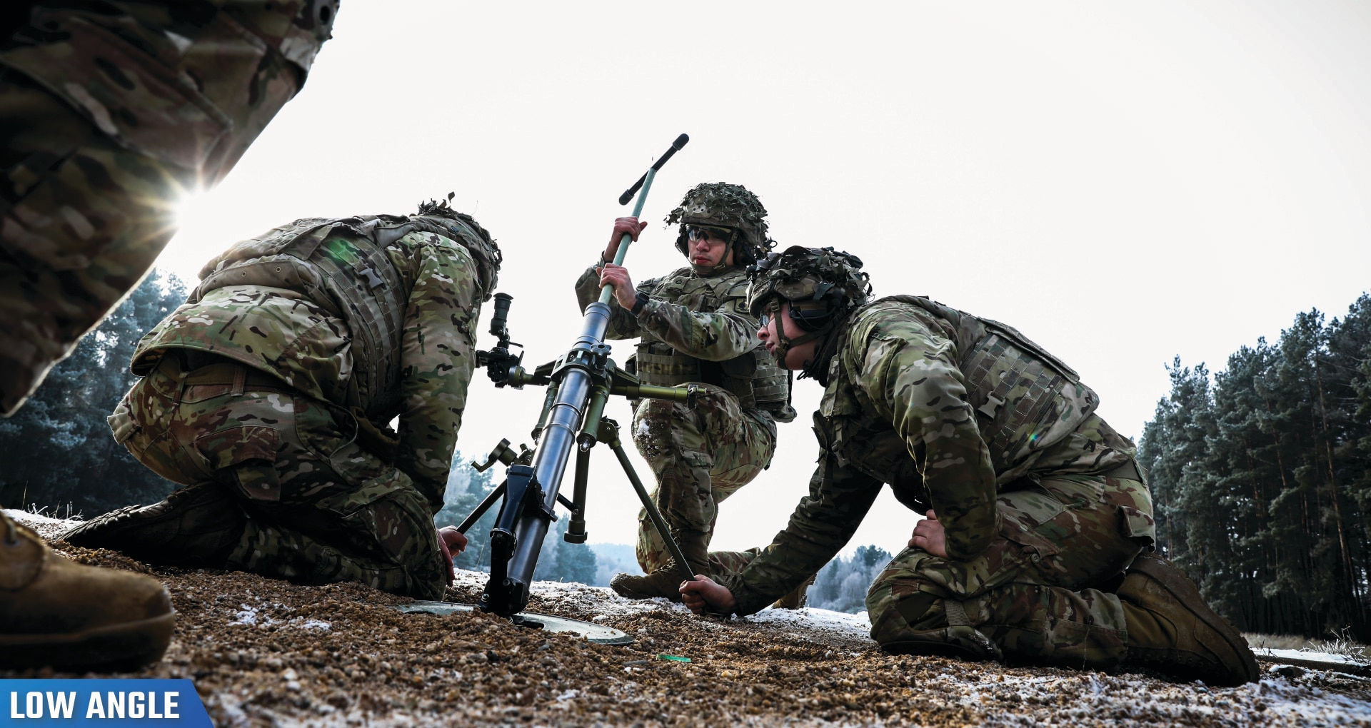 Paratroopers clean a 60mm mortar during a live-fire exercise at Grafenwoehr Training Area, Germany