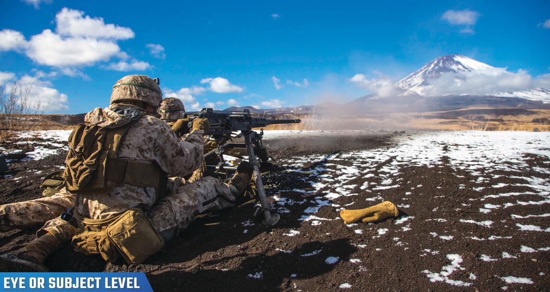A Marine fires a .50-caliber machine gun during Fuji Viper at Combined Arms Training Center Camp Fuji, Japan