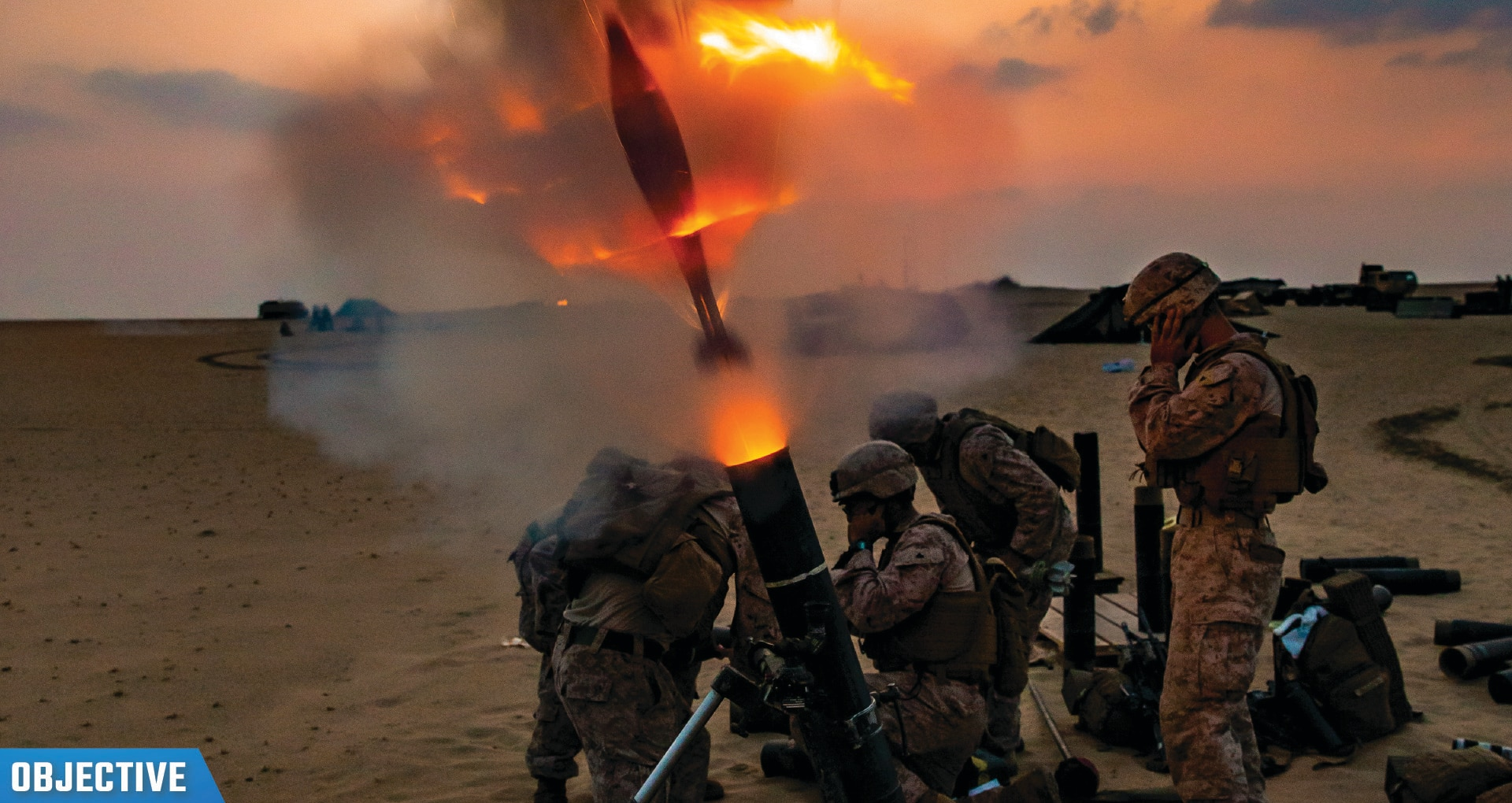 Marines fire a 120 mm mortar round during a live-fire training in Kuwait