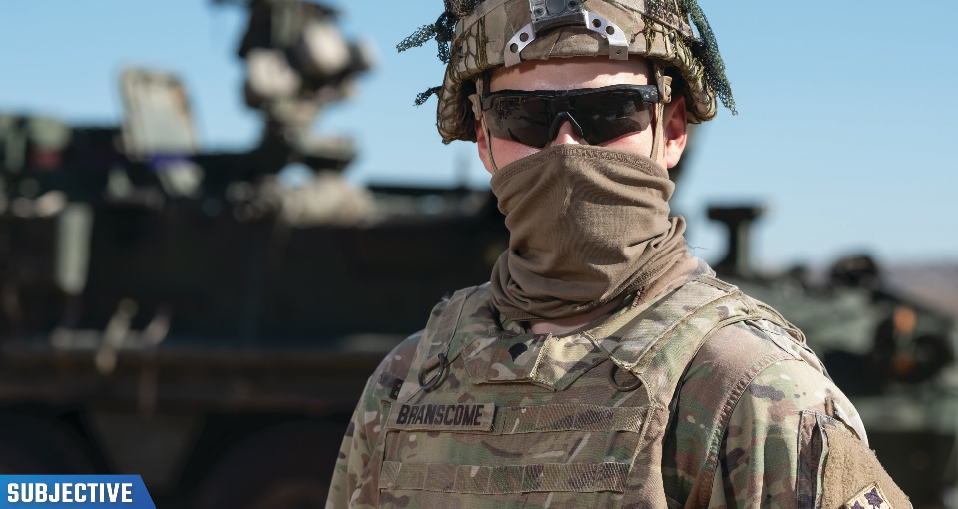 Image of a Cavalry Scout wearing sunglasses and gear outside