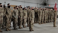 Soldiers with Bravo Company, 572nd Brigade Engineer Battalion, stand at attention during a deployment ceremony in Vergennes, Vermont, March 9, 2021. The Soldiers will deploy to the U.S. Africa Command area of responsibility. (U.S. Army National Guard photo by Josh T. Cohen)