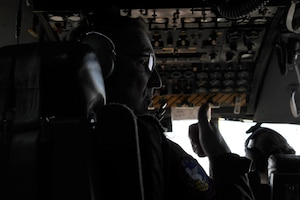 Tech. Sgt. Paul D. Purcell, a 700th Airlift Squadron flight engineer, gives a thumbs up while flying over Rome, Ga., March 4, 2021. Multiple C-130s flew together as part of Baltic Wolf 2021, a large formation exercise incorporating other units within the Air Force Reserve Command. (U.S. Air Force photo by Senior Airman Kendra A. Ransum)