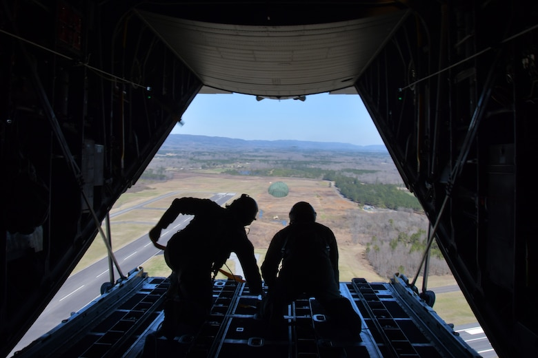 Master Sgts. Andrew S. Cline and Antwun T. Cotton, both 94th Operations Support Squadron loadmasters, release a Low-Cost-Low-Altitude airdrop over Rome, Ga. March 4, 2021. Multiple C-130s flew together as part of Baltic Wolf 2021, a large formation exercise incorporating other units within the Air Force Reserve Command. (U.S. Air Force photo by Senior Airman Kendra A. Ransum)