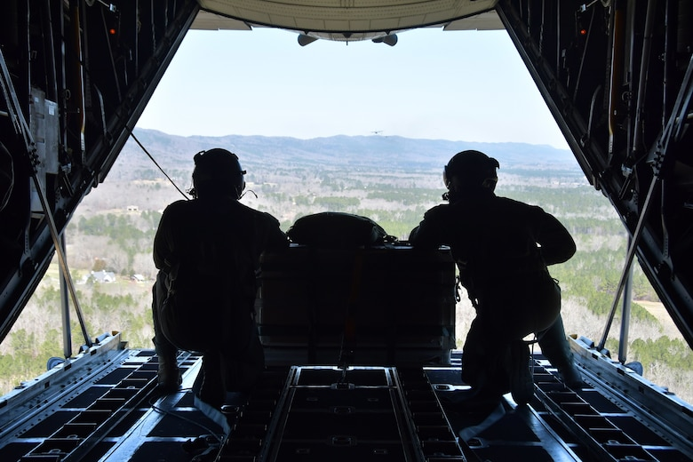 Master Sgts. Andrew S. Cline and Antwun T. Cotton, both 94th Operations Support Squadron loadmasters, prepare to drop a Low-Cost-Low-Altitude airdrop over Rome, Ga. March 4, 2021. Multiple C-130s flew together as part of Baltic Wolf 2021, a large formation exercise incorporating other units within the Air Force Reserve Command. (U.S. Air Force photo by Senior Airman Kendra A. Ransum)