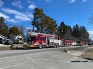 Photo of fire trucks outside home.