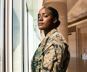 U.S. Marine Corps Sgt. Ravein S. Price Fitzgerald, a supply clerk with Recruiting Station Orange County, poses for a photo on March 5, 2021 in Santa Ana, California. Price Fitzgerald and fellow Marines gathered at RS Orange County in order to celebrate National Women's History Month. Women's History Month is impactful to women in the Corps because it allows them to acknowledge the milestones that Marines have gone through in order to get to where they are today. (U.S. Marine Corps photo by Sgt. Sarah Ralph)
