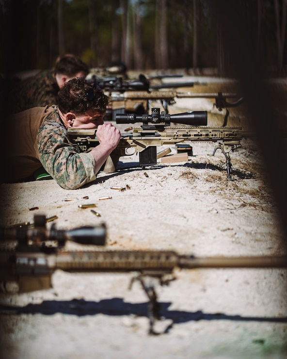 A U.S. Marine with 2d Reconnaissance Battalion (2d Recon Bn.), 2d Marine Division chambers a new round on range G-12, Camp Lejeune, N.C., March 8, 2021. 2d Recon Bn. and Royal Dutch Marines with 32nd Raiding Squadron utilized the range for sniper training during Exercise Caribbean Urban Warrior, a bilateral training evolution which increases interoperability between the two countries in different environments.(U.S. Marine Corps photo by Cpl. Corey A. Mathews)