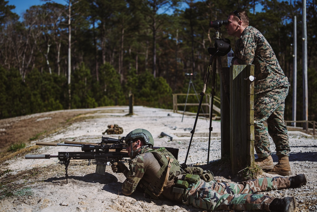 A U.S. Marine with 2d Reconnaissance Battalion (2d Recon Bn.), 2d Marine Division, uses a spotter's scope to observe impacts from a Dutch Marine with 32nd Raiding Squadron on range G-12, Camp Lejeune, N.C., March 8, 2021. 2d Recon Bn. and Royal Dutch Marines with 32nd Raiding Squadron utilized the range for sniper training during Exercise Caribbean Urban Warrior, a bilateral training evolution which increases interoperability between the two countries in various environments. (U.S. Marine Corps photo by Cpl. Corey A. Mathews)