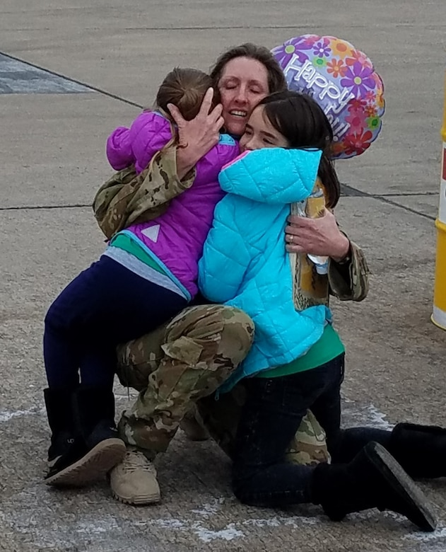 Col. Angela Ochoa when she returned from a deployment in 2018 to her two daughters, Elsa and Seanna. She shares a letter to them during Women's History Month about how to courageously lead based on some of the experiences she has had while in the Air Force. (Courtesy photo)