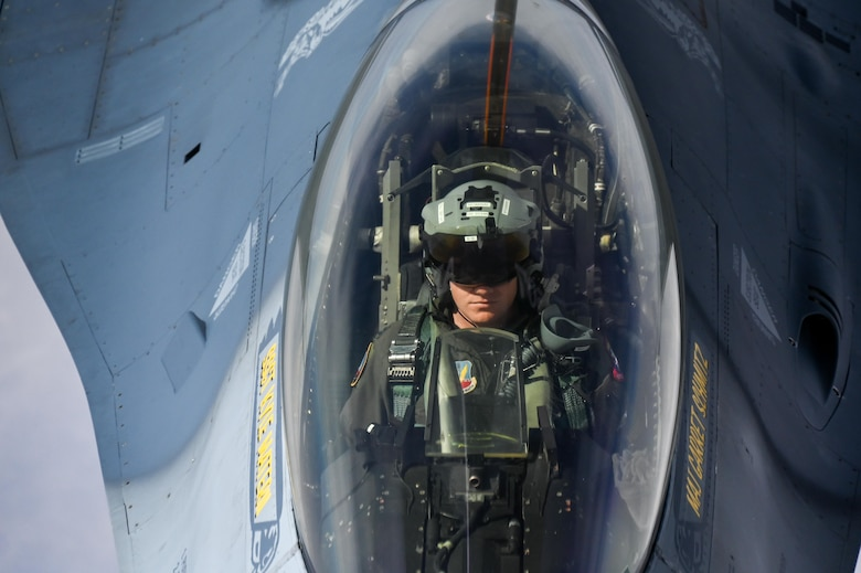 An F-16 Viper Demonstration Team pilot refuels with a KC-135 Stratotanker from the 465th Air Refueling Squadron assigned to Tinker Air Force Base, Oklahoma, March 8, 2021. The F-16 team from Shaw Air Force Base, South Carolina, is assigned to Air Combat Command received fuel from the Okies during their flight back to their home station after performing at an air show. (U.S. Air Force photo by Senior Airman Mary Begy)