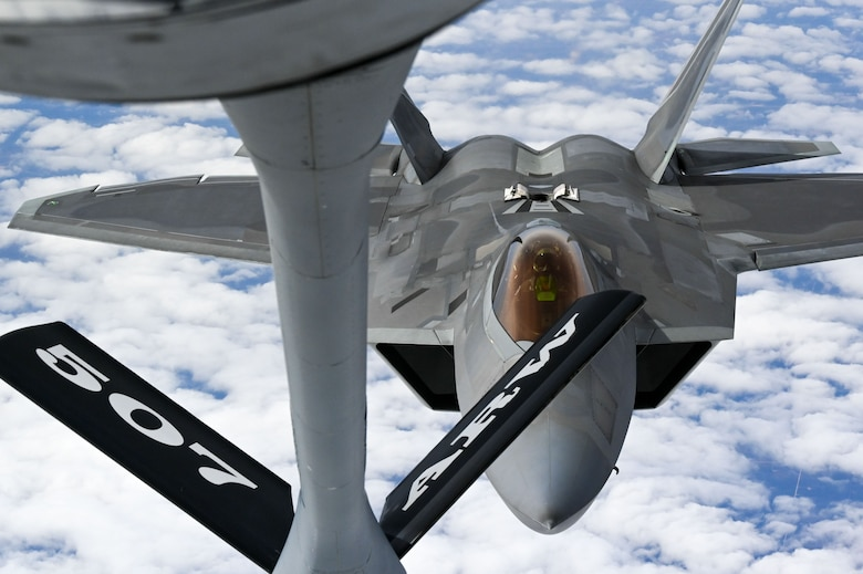 An F-22 Raptor Demonstration Team pilot refuels with a KC-135 Stratotanker from the 465th Air Refueling Squadron assigned to Tinker Air Force Base, Oklahoma, March 8, 2021. The F-22 team from Joint Base Langley–Eustis, Virginia, is assigned to Air Combat Command and received fuel from the Okies during their flight back to their home station after performing at an air show. (U.S. Air Force photo by Senior Airman Mary Begy)