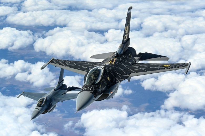 F-16 Viper Demonstration Team pilots fly behind a KC-135 Stratotanker from the 465th Air Refueling Squadron at Tinker Air Force Base, Oklahoma, March 8, 2021. The F-16 team from Shaw Air Force Base, South Carolina, is assigned to Air Combat Command and received fuel from the Okies during their flight back to  their home station after performing at an air show. (U.S. Air Force photo by Senior Airman Mary Begy)