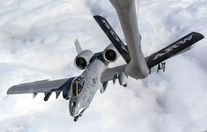An A-10 Thunderbolt II from the 75th Fighter Squadron, Moody Air Force Base, Georgia, refuels from a KC-135 Stratotanker from 465th Air Refueling Squadron, Tinker Air Force Base, Oklahoma, on their way to Red Flag March 5, 2021. Refueling with the Okies allowed the A-10s to make it to the exercise without having to land. (U.S. Air Force Base photo by Senior Airman Mary Begy)