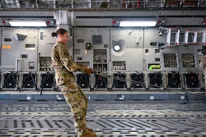 A student from the 97th Training Squadron loads a C-17 Globemaster March 4, 2021, Altus Air Force Base, Oklahoma. (U.S. Air Force photo by Senior Airman Mary Begy)