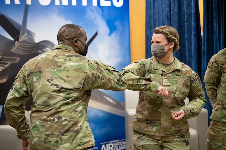 U.S. Air Force Chief Master Sgt. Maurice L. Williams, command chief, Air National Guard (ANG), congratulates Senior Airman Lauren Cray, assigned to the 158th Medical Group.